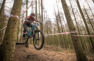 Flow MTB rider Kate Gries in action on the Wonderland trail at Stile Cop for the 2nd round of the Racers Guild